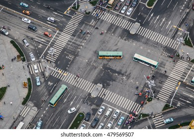 Rush hour traffic zips through an intersection in the CBD district of Kunming, China.