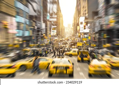 Rush hour with yellow taxi cabs and melting pot people on 7th av in Manhattan downtown before sunset - Bright blurred defocused postcard of New York City and his crowded traffic jam - Radial filter