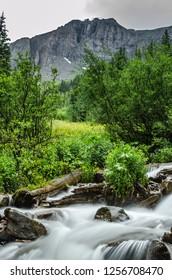 A rushing creek in motion high in a Colorado mountain basin