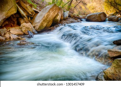 Rushing creek next to hiking trail
