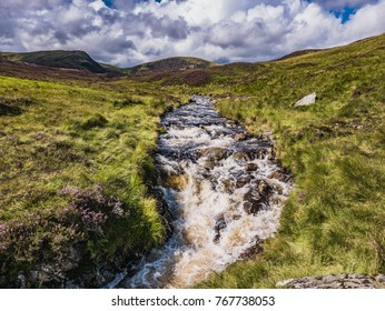 A rushing stream flows from the Grey Mare's Tail Waterfall, Southern Uplands, Scotland