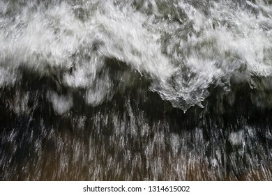 rushing water with motion blur and white waves