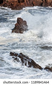 rushing waves on the rocks of the french riviera coast