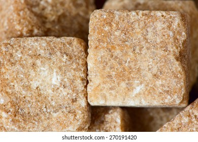 Rushy raw sugar cubes close up