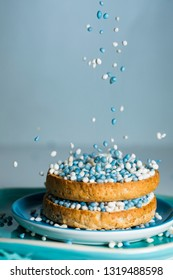rusk with falling blue aniseed balls, muisjes. tradition in the Netherlands to celebrate the birth of a son