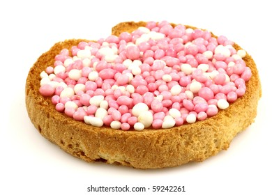 rusk with white and pink anise seed sprinkles served in Holland when a baby girl is born on a white background