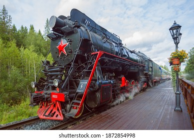 """RUSKEALA, RUSSIA - AUGUST 15, 2020: Soviet steam locomotive of the """"L"""" series with the tourist train """"Ruskeala Express"""" at the platform of the Ruskeala railway station"""