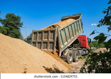 rusovich pours sand on the construction site