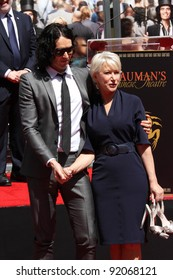 Russell Brand and Helen Mirren at the Helen Mirren Hand and Foot Print Ceremony, Chinese Theater, Hollywood, CA. 03-28-11