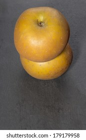 Russet apples on slate