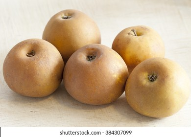 Russet apples on table