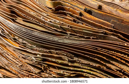Russet curved metal layers background