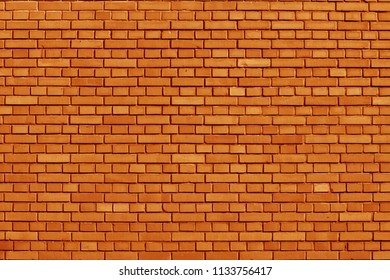 Russet Orange colored brick wall background