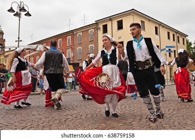 RUSSI, RA, ITALY - AUGUST 2: the folk dance ensemble Irizema from Calabria, Italy, performs traditional dance tarantella during the Folklore Festival, on August 2, 2015 in Russi, Ravenna, Italy