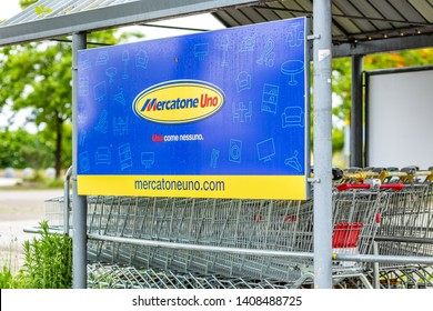 RUSSI (RA), ITALY - MAY 27, 2019: sunlight is enlightening and raindrops are covering the logo of Mercatone Uno on a gloomy day. Company went bankrupt last week