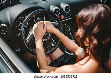 Russia / Altai / Barnaul / July 30. 07.2017: The girl in the cabriolet. Beautiful girl. Audi. A car. Interior of the car. girl in Audi convertible.