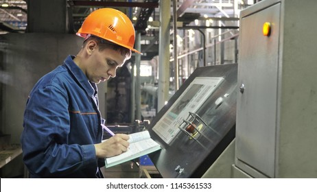 RUSSIA, ANGARSK - JUNE 8, 2018: Operator monitors control panel of production line. Manufacture of plastic water pipes of the factory. Process of making plastic tubes on machine tool with the use of