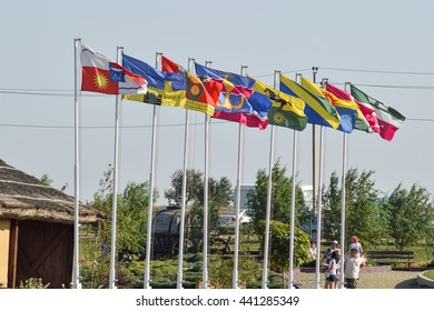 Russia, Ataman - 26 September 2015: A number of different flag with coats of arms and banners. Flags hanging in the Cossack village