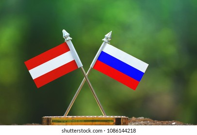 Russia and Austria small flag with blur green background