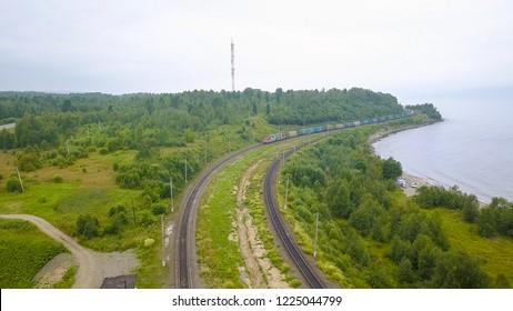Russia, Baikal: Trans-Siberian Railway, the coast of Lake Baikal. Movement of trains on the iron bridge across the river flowing into Baikal, From Drone