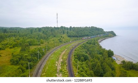 Russia, Baikal. Trans-Siberian Railway, the coast of Lake Baikal. Movement of trains on the iron bridge across the river flowing into Baikal, From Drone