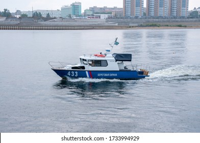 Russia, Blagoveshchensk, July 2019: marine patrol boat on the Amur river in the city of Blagoveshchensk in the summer
