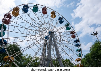 Russia, Blagoveshchensk, July 2019: Summer. Ferris wheel in the city Park of culture and recreation in the center of Blagoveshchensk