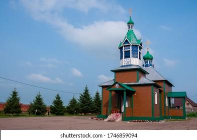 Russia, Blagoveshchensk, July 2019: Summer. Wooden rural Church in the village of Ignatievo near the city of Blagoveshchensk