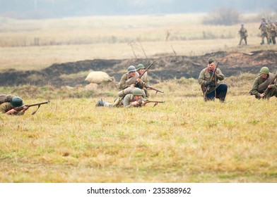 RUSSIA, BORODINO - OCTOBER 12: Unidentified armed soldiers of hiking squad shooting on reenactment of the battle in WWII near the Borodino village in 1941, Borodino, on 12 October, 2014, Russia