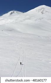 Russia. Caucasus. Kabardino-Balkaria. Elbrus ski resort. Winter mountain scenery. Elbrus Mount. Free-ride. Skiers descending from the mount