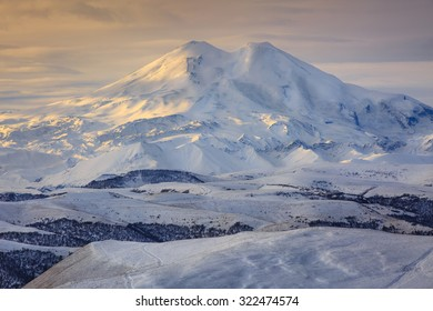 Russia, the Caucasus Mountains, Kabardino-Balkaria. Mount Elbrus in the autumn sun at daybreak.
