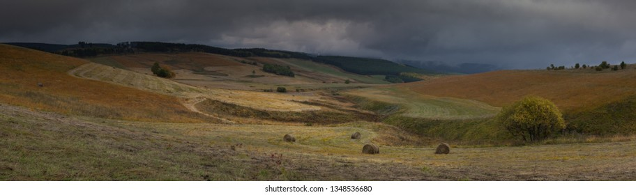 Russia, the Caucasus Mountains, Kabardino-Balkaria. Storm clouds over the sloping meadows in the mountains.