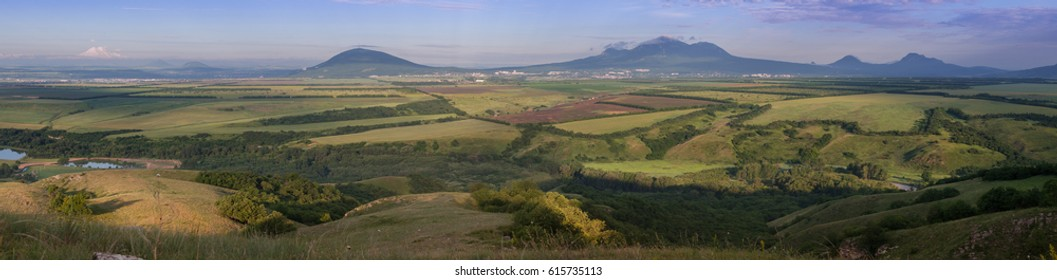 Russia, the Caucasus Mountains,Stavropol Territory. panorama. The city of Pyatigorsk is surrounded by mountains and fields in the summer morning.