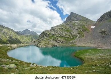 Russia, Caucasus. View of the lake Upper Kardyvach and neighboring mountains.