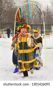 Russia, central part, february, celebration of maslenitsa 2014. Holiday maslenitsa. Winter snow. Children with donuts. We are seeing winter, we meet spring.