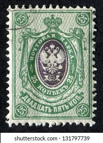 RUSSIA - CIRCA 1909: A stamp printed in Russia shows Imperial Eagle and Post Horns with Thunderbolts. Vertical Lozenges of Varnish on Face. Scott Catalog 83 A11 25k green, circa 1909