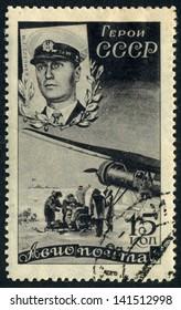 RUSSIA - circa 1938: stamp printed by Russia, shows Soviet aviator Mavriky Slepnyov, old plane circa 1938