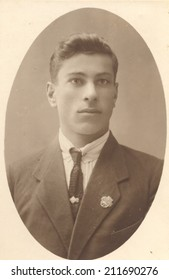 Russia, - CIRCA 1939s: An antique studio portrait of young man in a business suit.