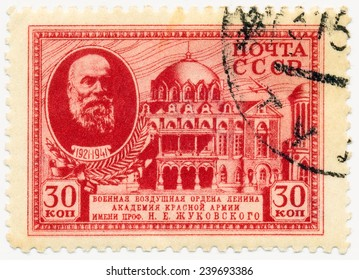 RUSSIA - CIRCA 1941: A stamp printed in USSR, shows portrait of Prof. Zhukovski, scientist (1847-1921) and Military Air Academy, circa 1941