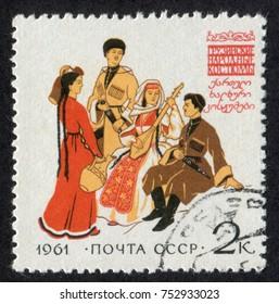 RUSSIA - CIRCA 1961: A stamp printed in USSR (Soviet Union), shows Regional Folk Costumes. Georgian Folk Costumes, circa 1961