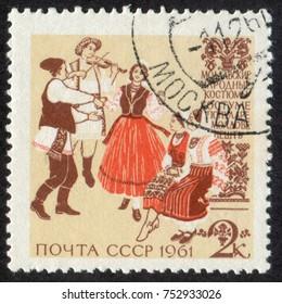 RUSSIA - CIRCA 1961: A stamp printed in USSR (Soviet Union), shows Regional Folk Costumes. Moldovian Folk Costumes, circa 1961