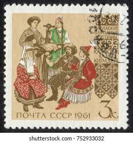 RUSSIA - CIRCA 1961: A stamp printed in USSR (Soviet Union), shows Regional Folk Costumes. Kazakh Folk Costumes, circa 1961