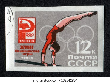 RUSSIA - CIRCA 1964: A stamp printed in USSR (Soviet Union), shows Girl gymnast. and Russian Olympic Emblem. 18th Olympic Games, Tokyo, Scott Catalog 2925 A1465 12k gray and red, circa 1964