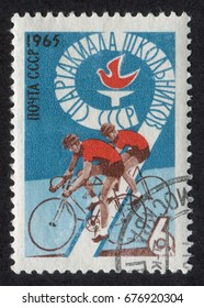 """Russia - CIRCA 1965: A Stamp printed in USSR (Soviet Union) shows two cyclists. From the series """"9th All-Union School Spartakiad"""", circa 1965"""