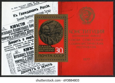 Russia - CIRCA 1977: A stamp printed in the Soviet Union shows images of USSR Izvestia news with first law Decrees and a New Constitution. Souvenir Sheet from Glory to Great October series, circa 1977