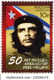 RUSSIA - CIRCA 2009: A stamp printed in Russia shows commander Ernesto Guevara de la Serna (Che Guevara) and Republic of Cuba national flag, 50th anniversary of Cuban revolution Victory, circa 2009