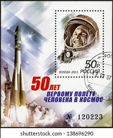 """RUSSIA - CIRCA 2011: A stamp printed in Russia shows Yuri Gagarin (1934-1968) and spaceship """"Vostok"""", The 50th anniversary of the first human spaceflight, circa 2011"""