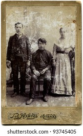RUSSIA - CIRCA  the end of 19 - early 20 century: An antique photo shows Two men and a woman, Lugansk, Russian Empire, now Ukraine Russian text: Yukhmov (photographer), Lugansk