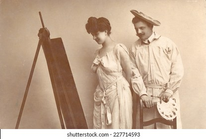 RUSSIA - CIRCA end of 19th - early 20th century:: An antique Black & White photo of painter man and woman near easel.