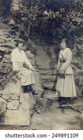 RUSSIA - CIRCA end of 19th - early 20th century: An antique photo shows of Two young beautiful girls posing at garden